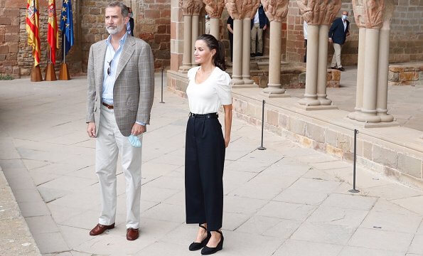 Queen Letizia wore a new puff sleeve sweater by Massimo Dutti. Castaner Carina ankle tie wedge sandals, Emporio Armani trousers