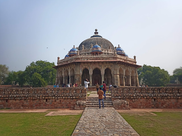 Tomb building of Isa Khan, built of stone with wall surrounding it