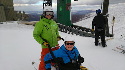 Photo of me and Peter (teacher) getting ready to get on the lift