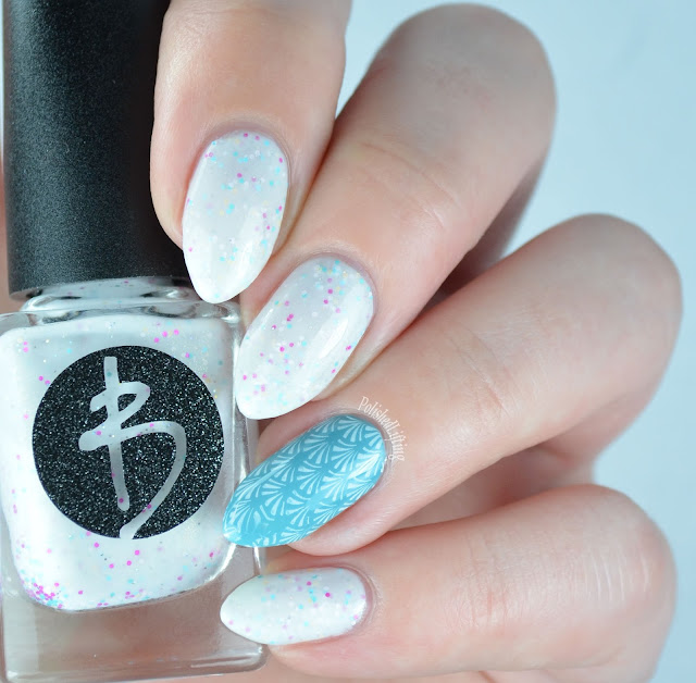 White nail polish with glitter and stamping