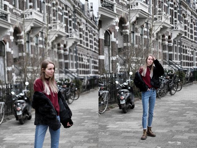 Outfit met tweekleurige Didi spijkerbroek bordeaux rode H&M trui zwarte bontjas en Dr martens Nijmegen
