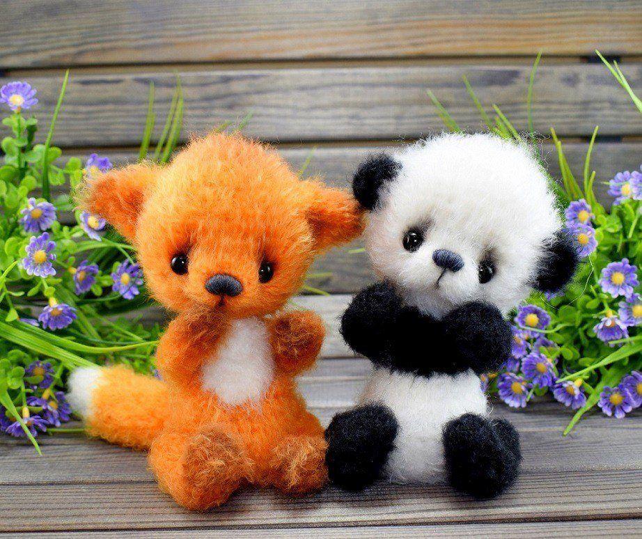 Вязаные игрушки лиса и панда амигуруми