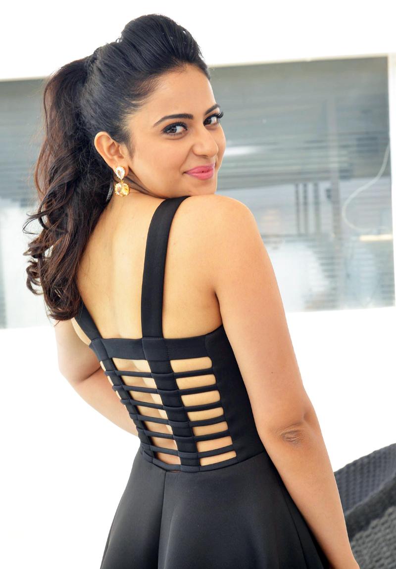 Rakul Preet Singh In Ponytail Hair Style Black Dress