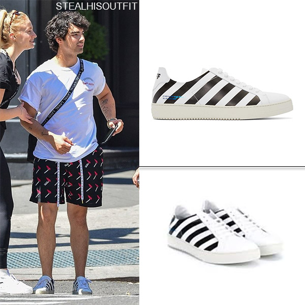 Joe Jonas wears white and black striped sneakers off-white celebrity footwear