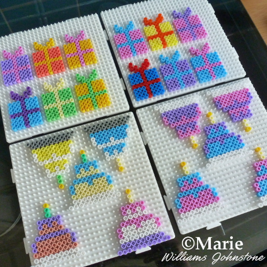 Batch Making Perler Bead Party Favors batching small fused designs patterns on a large pegboard peg board