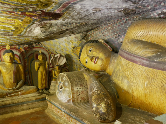 Dambulla cave buddha statues with mural paintings on the ceiling - Sri Lanka