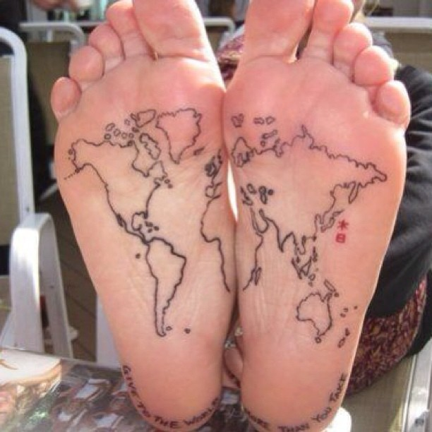 earth tattoo on foot face