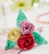 http://www.letsknit.co.uk/free-knitting-patterns/floral-brooch