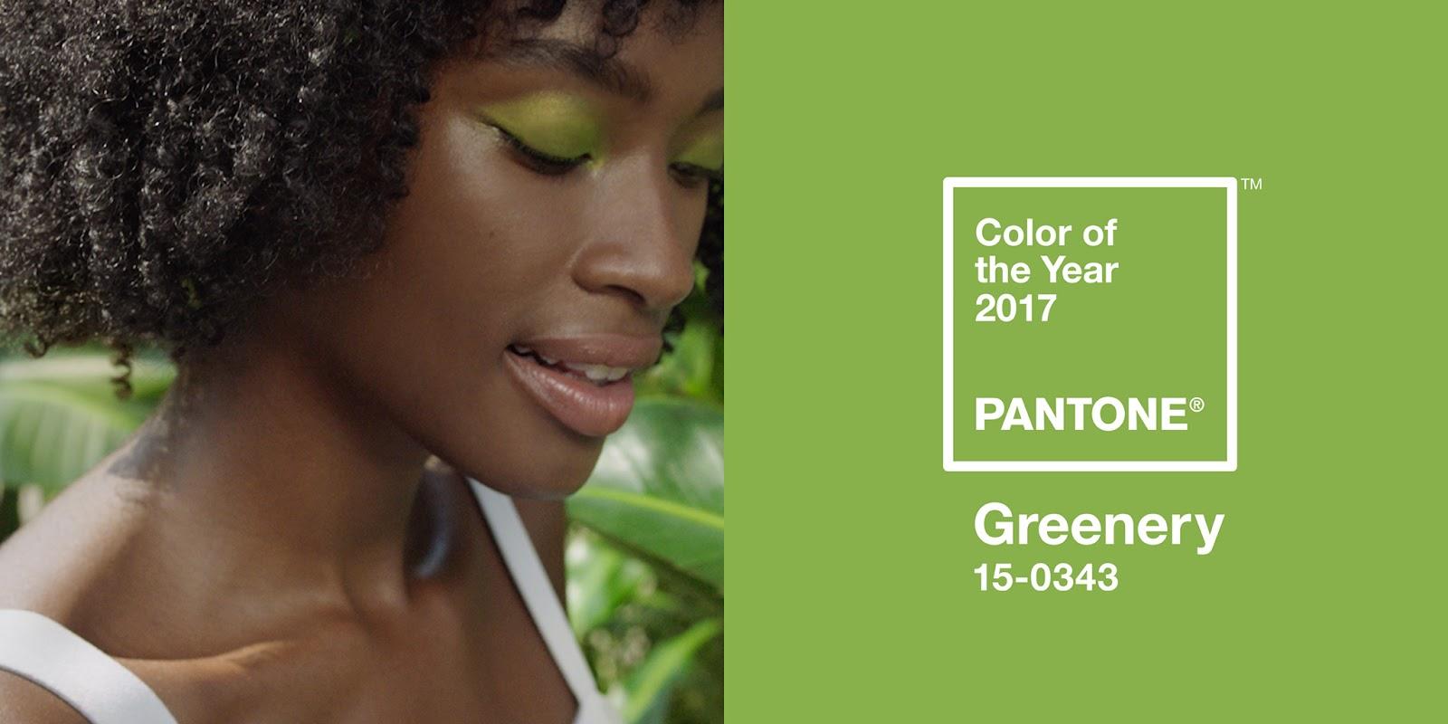 a black woman with green eyeshadow