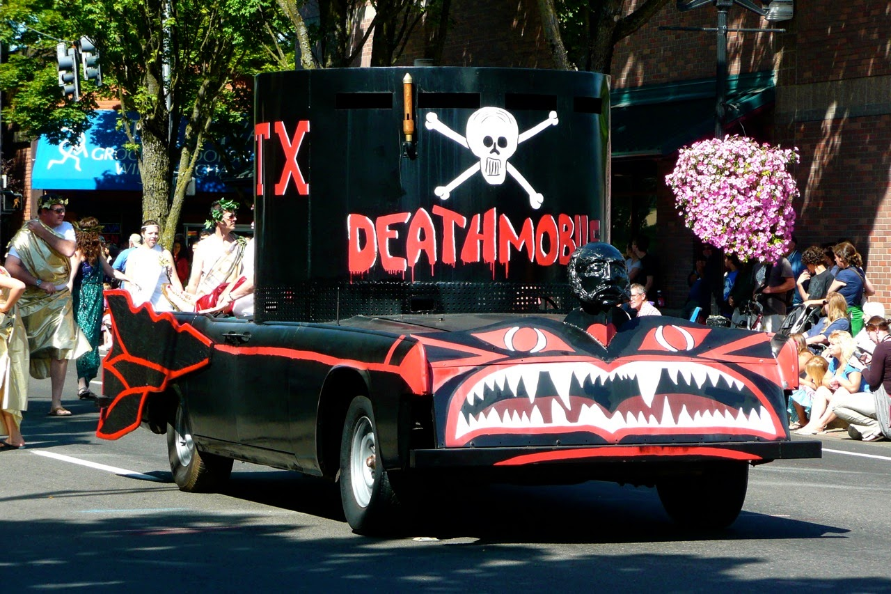 Eugene Celebration parade, death float, Lincoln convertible, skull and crossbones, downtown traffic