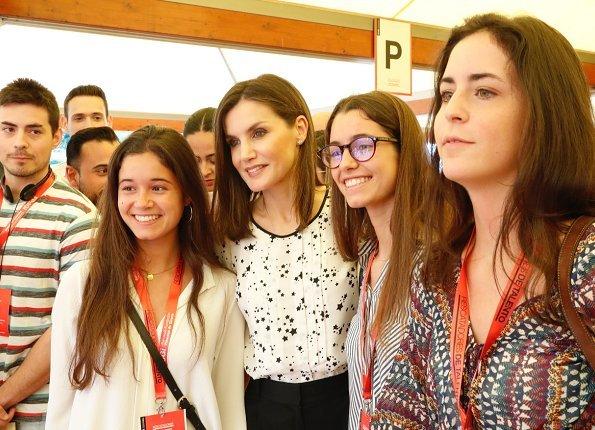 Queen Letizia wore Carolina Herrera floral print silk blouse for Girona Foundation's meeting at Malavella Hotel Camira in Girona