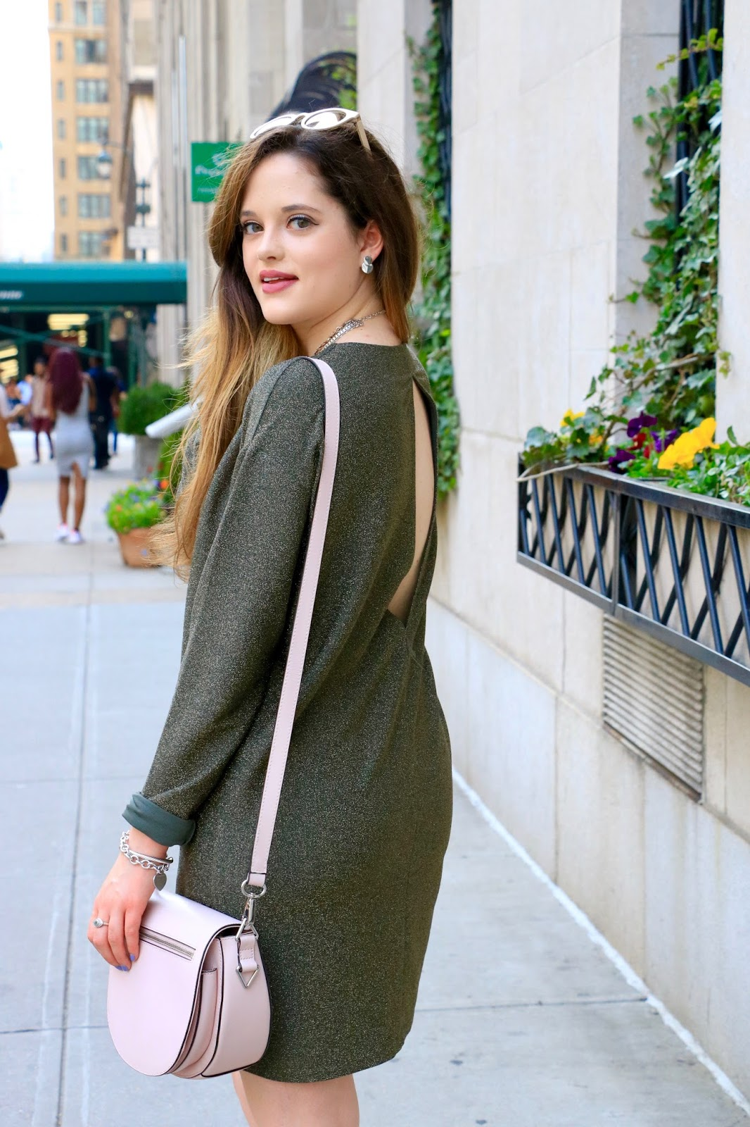 Fashion blogger Kathleen Harper wearing an open-back dress