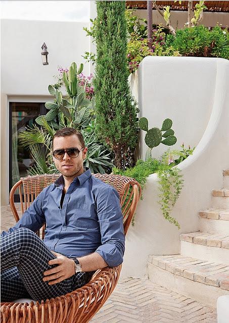 Jean Louis Deniot sitting outside a home he designed Capri via belle vivir blog