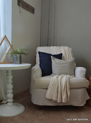 Ticking pillow and denim pillow on Dropcloth slipcovered chair