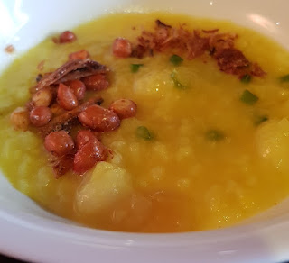 Bubur asyura is a bright yellow porridge.