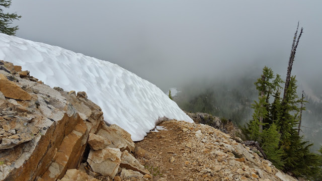 Snow wall blocks the PCT.