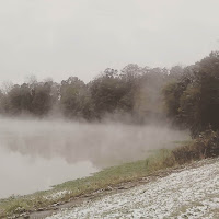 light snow in grass, mist rising above the pond in louisiana