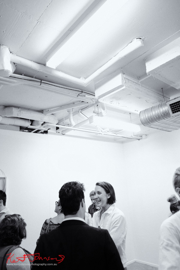 Talking at the opening. COMA Gallery & Art Opening - Photographed by Kent Johnson for Street Fashion Sydney.