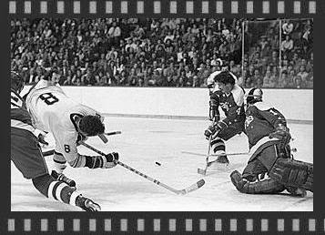 11/7/74:  Puck skitters to Bill Mikkelson