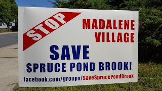 Stop Madalene Village sign