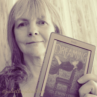Juliet Boyd holding a copy of The Cure for Dreaming by Cat Winters