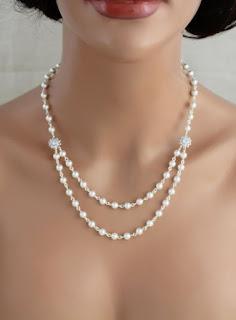 https://www.amazon.in/gp/search/ref=as_li_qf_sp_sr_il_tl?ie=UTF8&tag=fashion066e-21&keywords=white pearls   two layer&index=aps&camp=3638&creative=24630&linkCode=xm2&linkId=8bbafa458bd4e0efba2d692059f553b7