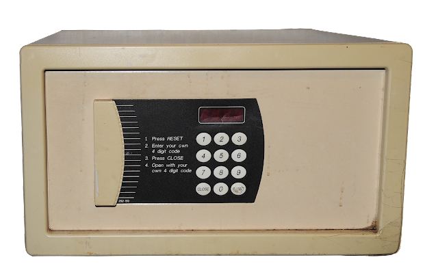 A small metal personal safe of the type found in many hotel rooms.