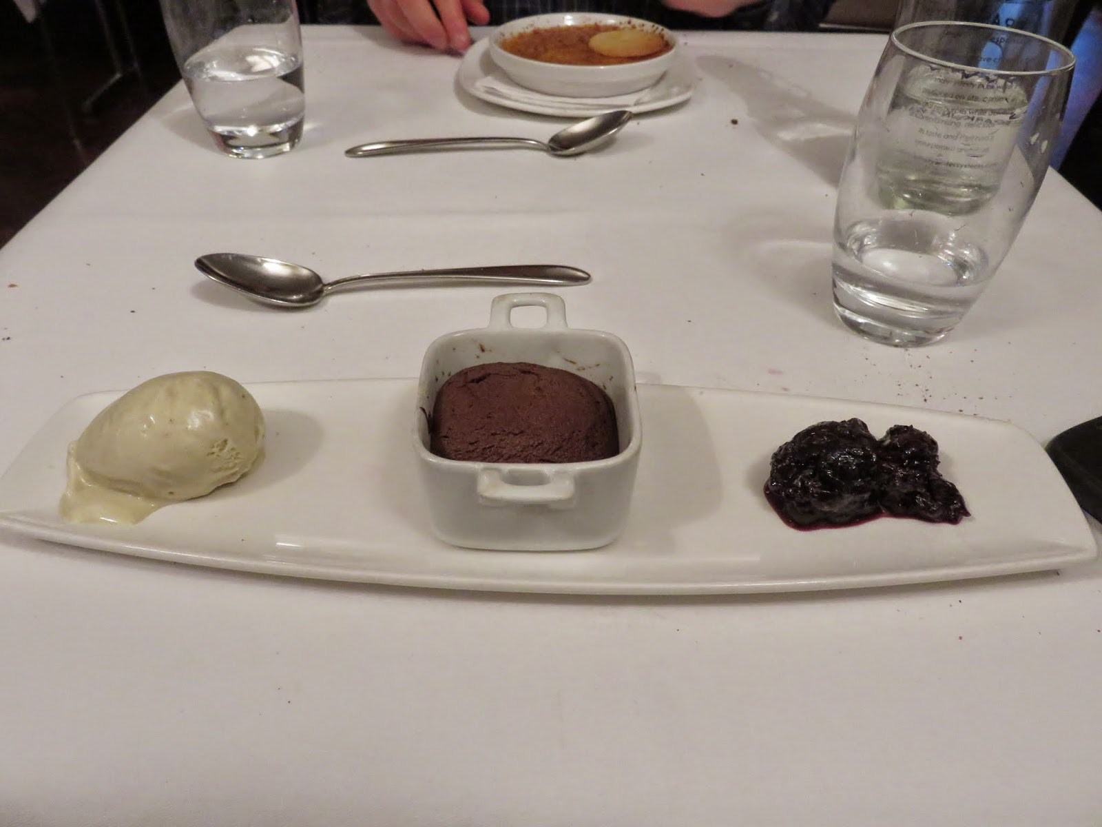 warm chocolate fondant served in a mini-casserole dish with vanilla ice cream and cherry compote