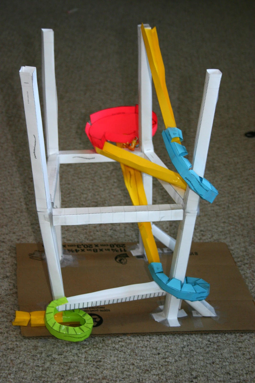 How to make science project roller coasters party for Paper roller coaster loop template