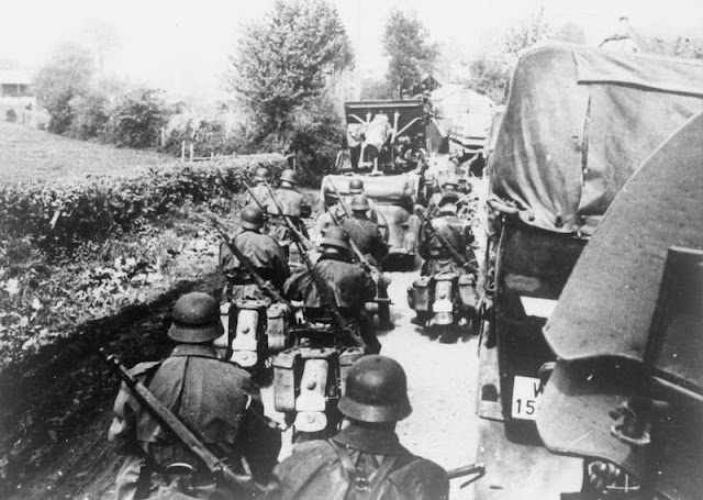 A German convoy of trucks and motorcycles in Belgium on their way to France, 1940