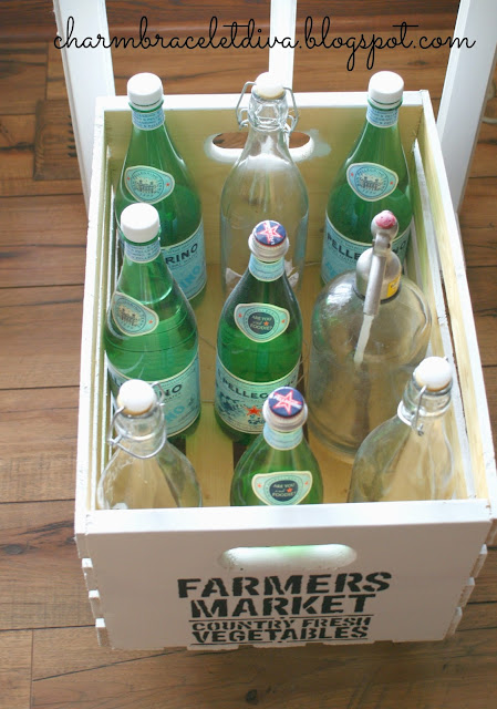 Vintage-inspired rolling pantry cart filled with Pellegrino bottles