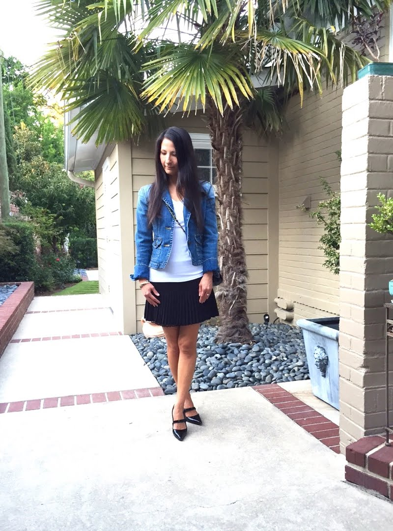 Denim and Black Outfit head tilted down.
