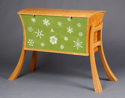 blanket chest, partially painted green with snowflakes