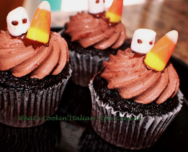 These are an easy homemade from scratch Halloween Cupcake decorate with candy corn and chocolate frosting