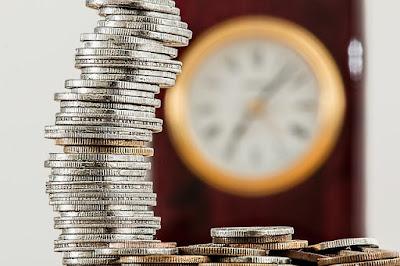 uang receh ditumpuk gambaran asuransi untuk keluarga