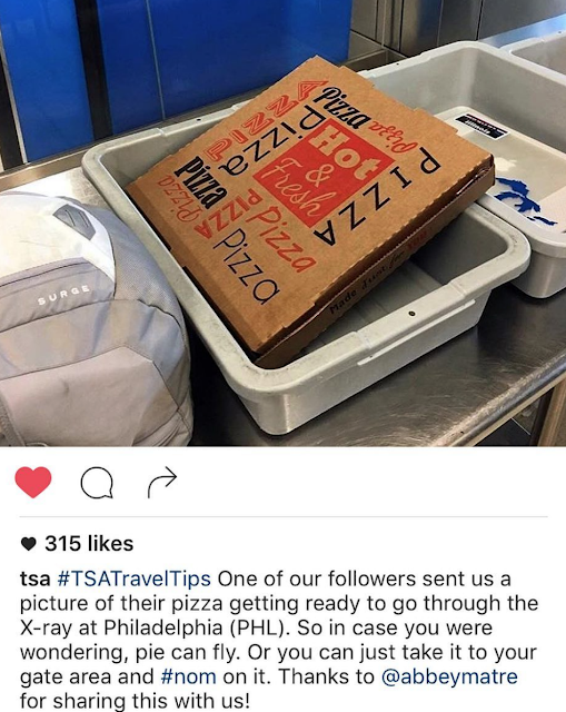 #TSATravelTips Pizza in Philadelphia going through the x-ray. Cleared to fly.