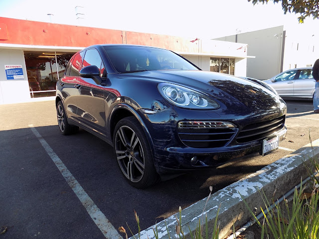 Porsche Cayenne hit by a concrete pillar before repairs at Almost Everything Auto Body.