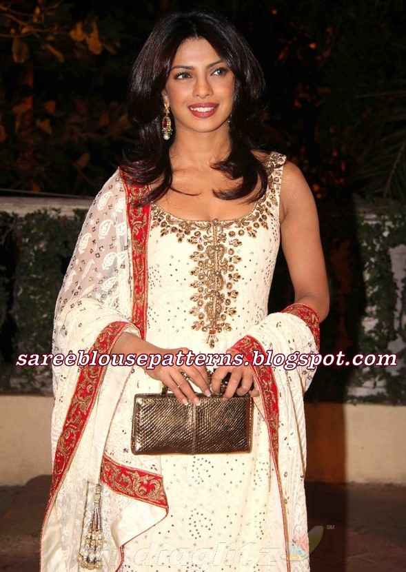 454443bc9a2 Bollywood actress Priyanka Chopra in off white printed designer salwar  kameez with gold embroidery lace border and sleeveless kameez paired with  churidaar ...