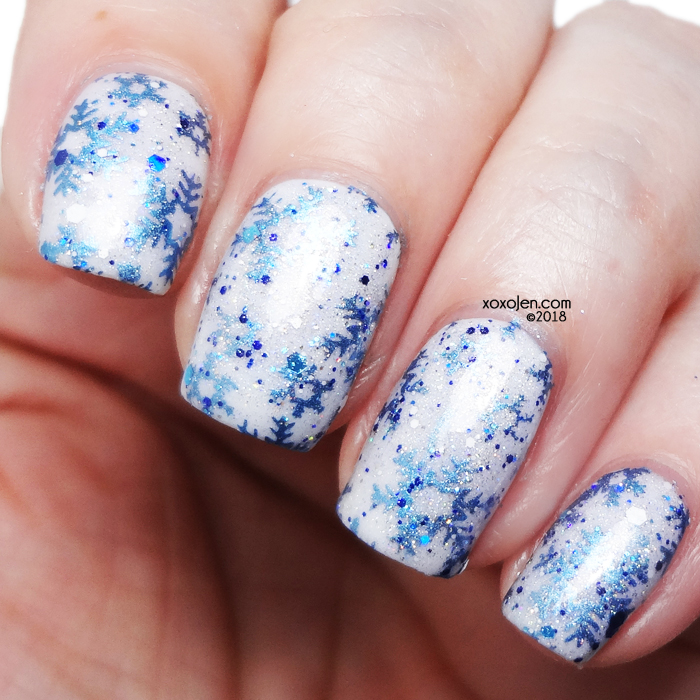xoxoJen's swatch of Twisting Nether stamping nailart