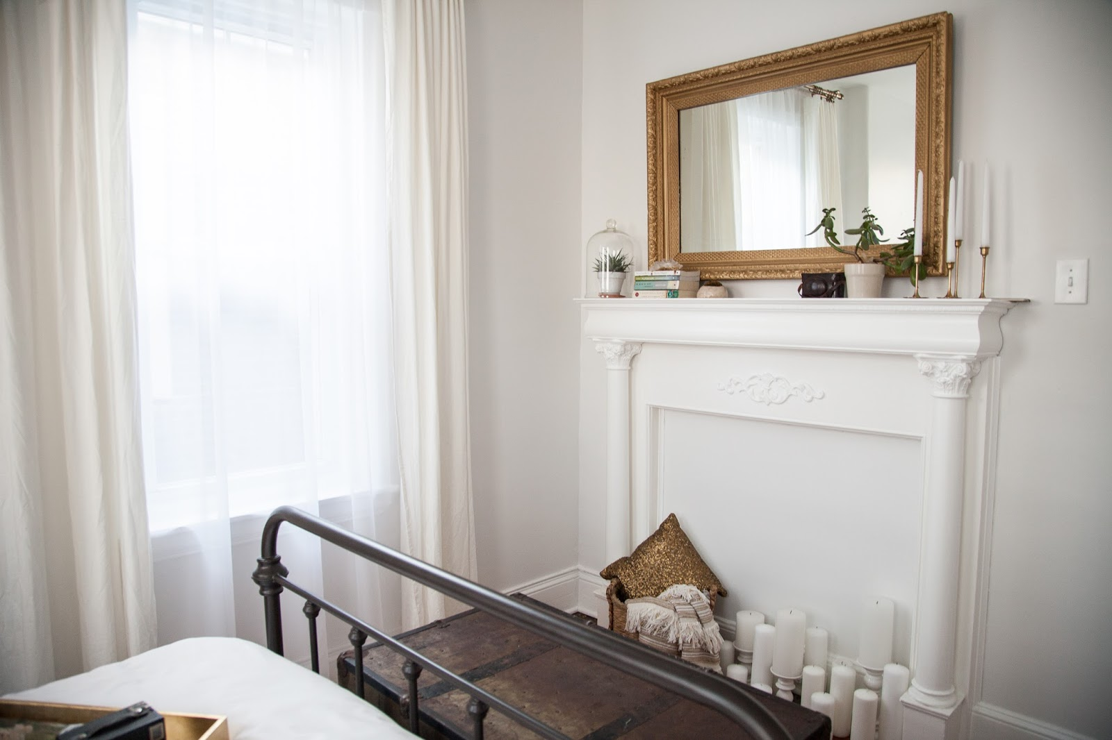Guest Room with Vintage Mantel and Gold Mirror