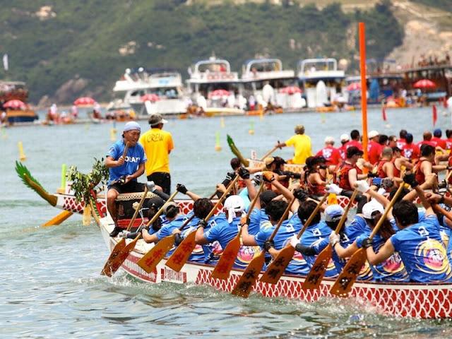 Lomba perahu naga Musi Triboatton