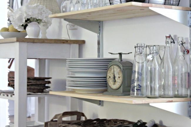 Love these vintage milk jars and scale in this kitchen