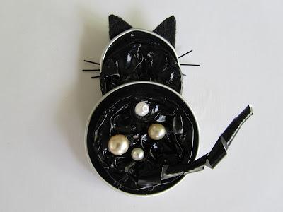 Black cat with Nespresso