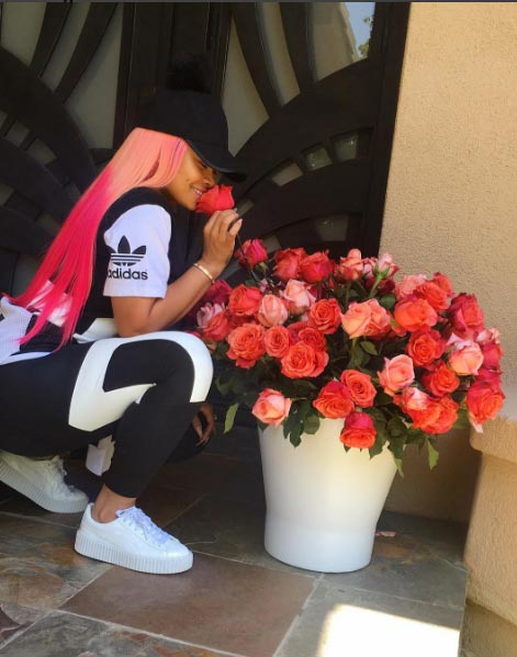 Blac Chyna looks fresh as she smell rose flowers growing in her house