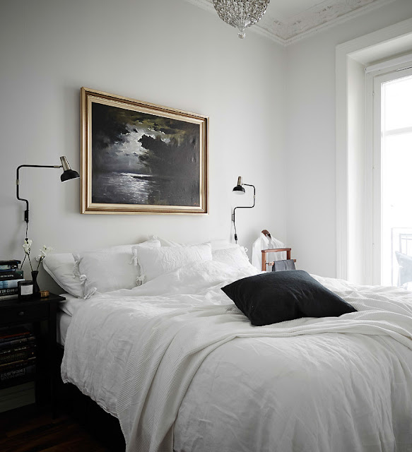 bedroom with vintage painting