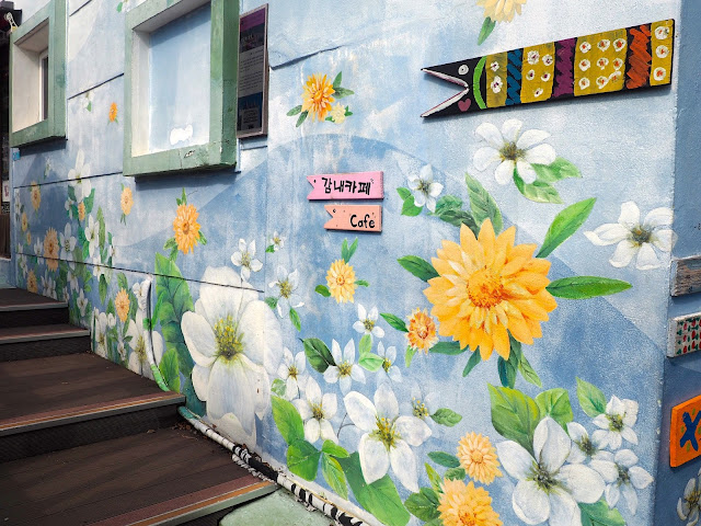 Flower mural and fish sign in Gamcheon Village, Busan, South Korea