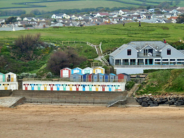 Beach huts and beach at Bude, Cornwall