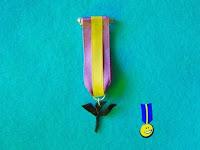 Foto medalla de fimo con el símbolo psique