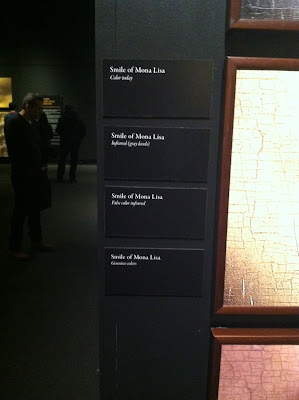 Smile of Mona Lisa:  Color today, Infared Grey Colors, False Infared, Genuine Color Da Vinci The Genius Exhibit signs