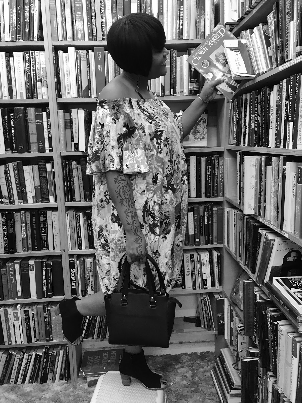 Image:Woman on step stool looking through books and other things at the store. Blog post on Bits and Babbles